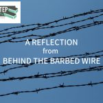 A Reflection from Behind the Barbed Wire